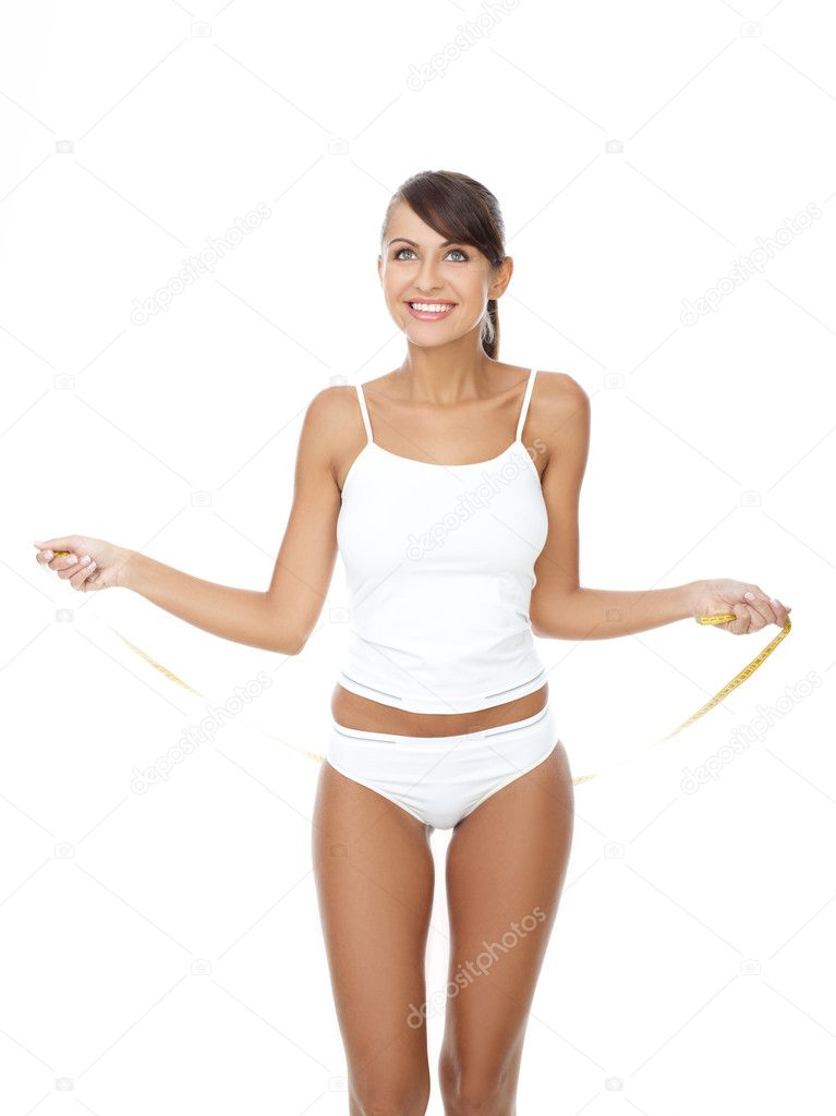 Young beautiful woman with measure tape on white  Stock Photo #1946891