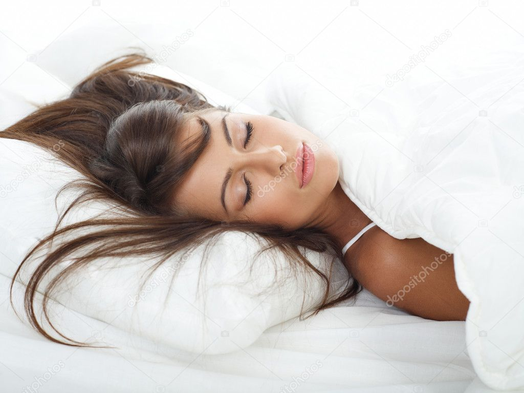Portrait of beautiful woman in white bed — Stock Photo #1946945