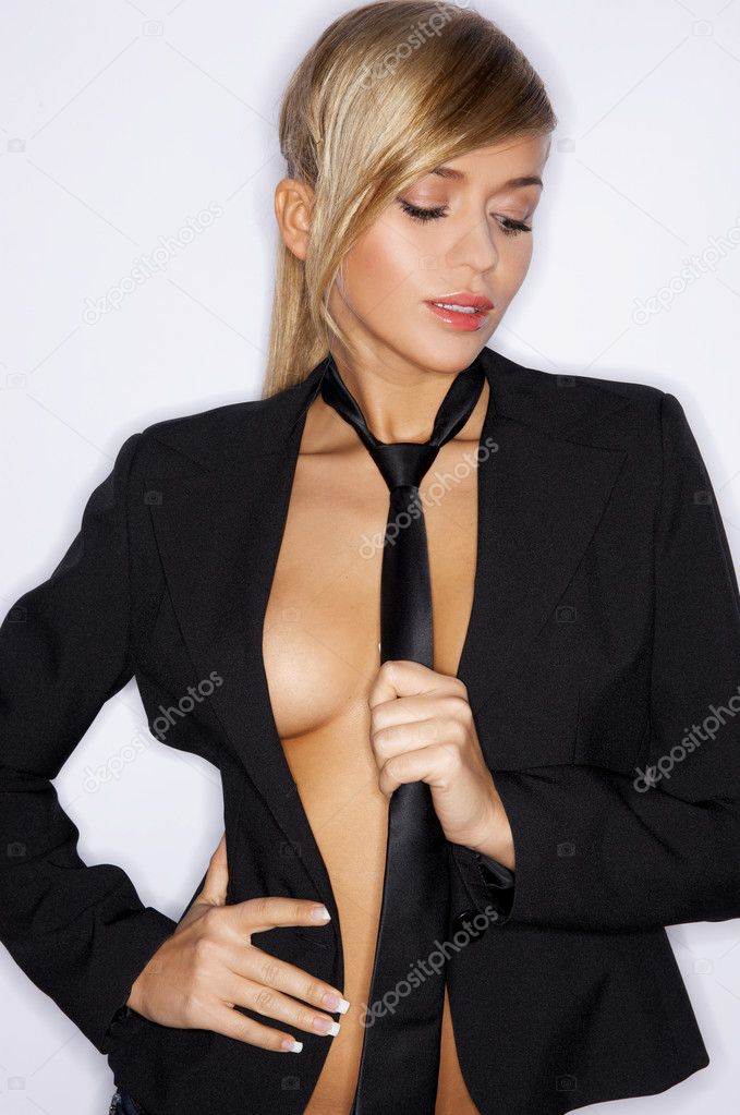 Beautiful sexy woman wearing black suit and tie