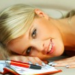 Blonde woman with datebook - Stock Photo