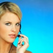 Young pretty woman wearing a phone headset — Stock Photo #1956046