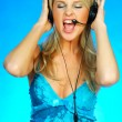 Young pretty woman wearing a phone headset - Stock Photo
