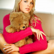 Sexy blonde girl with teddy bear — Stock Photo #1956413