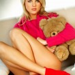 Sexy blonde girl with teddy bear — Stock Photo