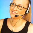 Young pretty woman wearing a phone headset. — Stock Photo
