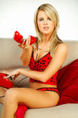 Sexy Blonde girl with red phone — Stock Photo
