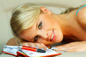 Blonde woman with datebook — Stock Photo