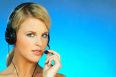 Young pretty woman wearing a phone headset — Stock Photo