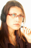 Young pretty woman wearing a phone headset. Call Centre Agent — Stock Photo