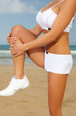 Fitness on beach — Stock Photo