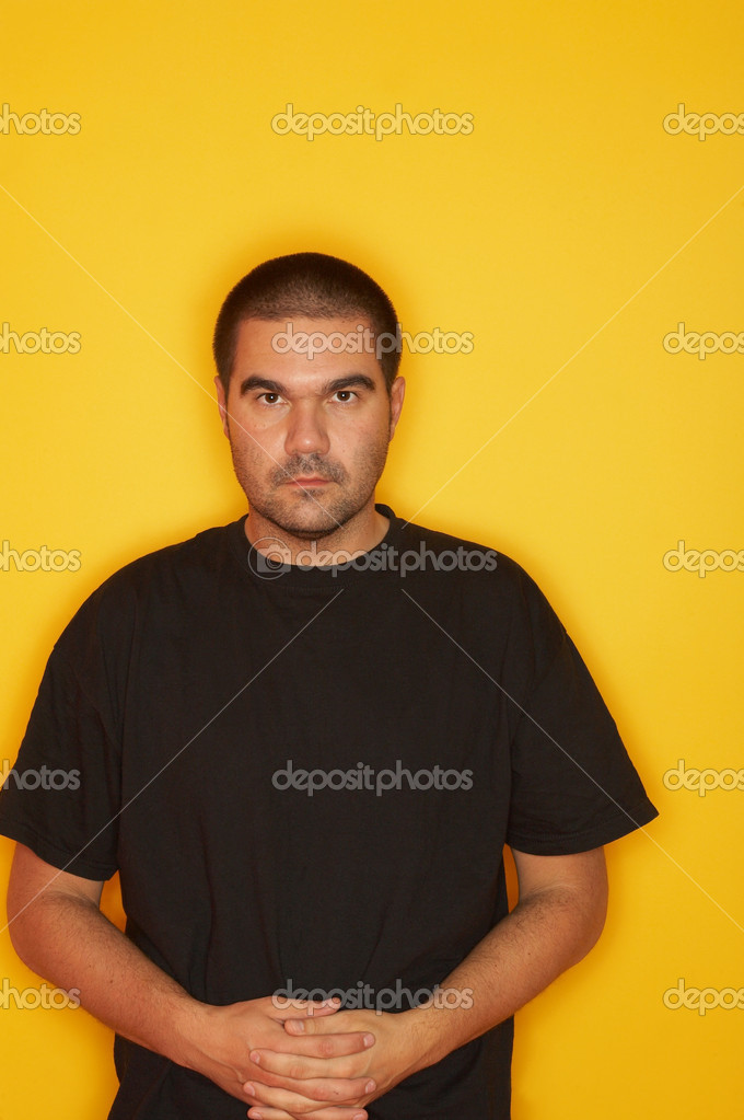 25-30 years old handsome caucasian man posing at yellow background  Stock Photo #1957148