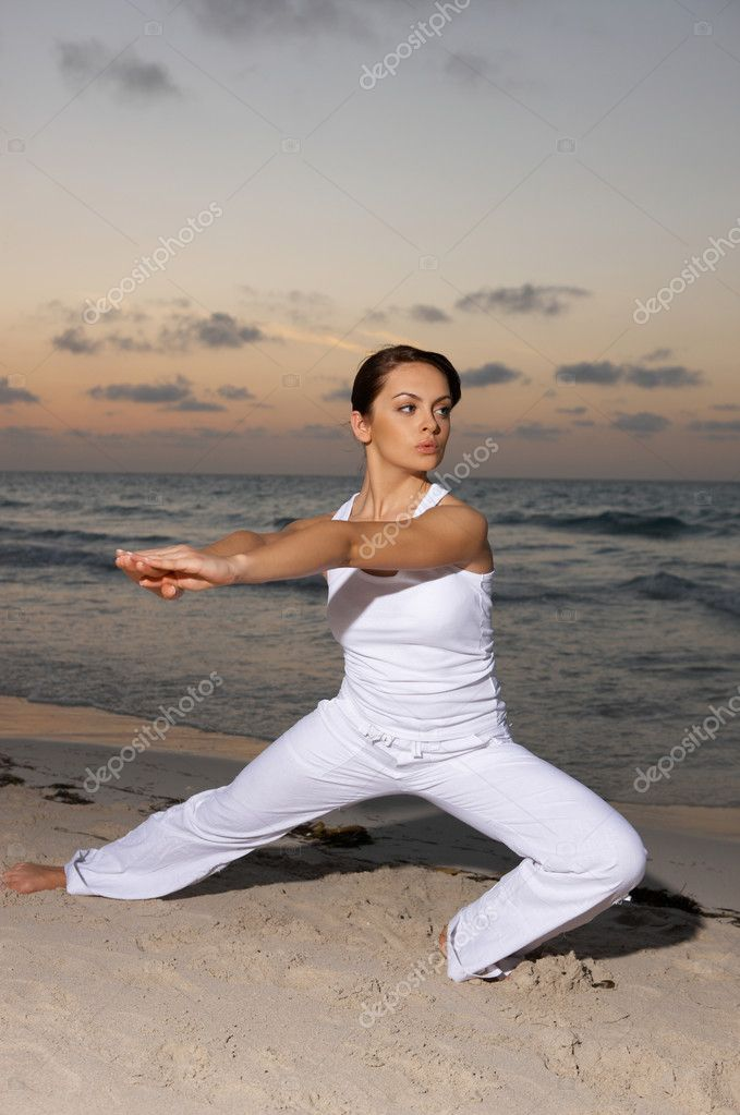 Young beautiful woman during fitness on sea beach  — Stock Photo #1957627