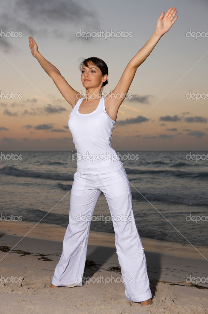 Young beautiful woman during fitness on sea beach  — Stock Photo #1957647