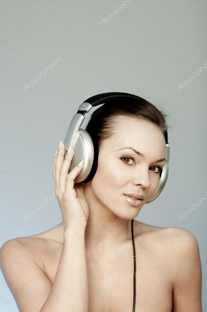 Portrait of Fresh and Beautiful sexy young woman with headphones — Stock Photo #1958399