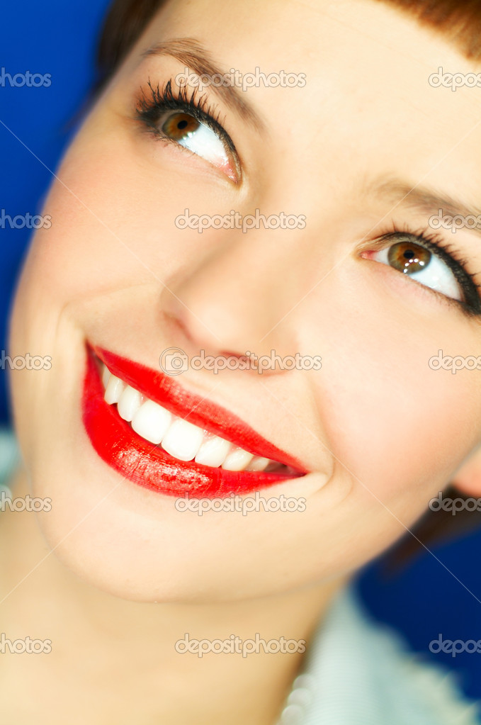 Portrait of beautiful young  smiling woman with red lipstick — Stock Photo #1958532