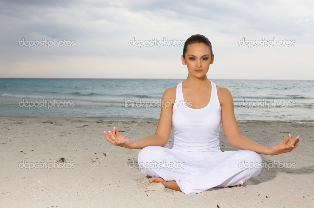 Young beautiful woman during yoga on sea beach  — Stock Photo #1958927