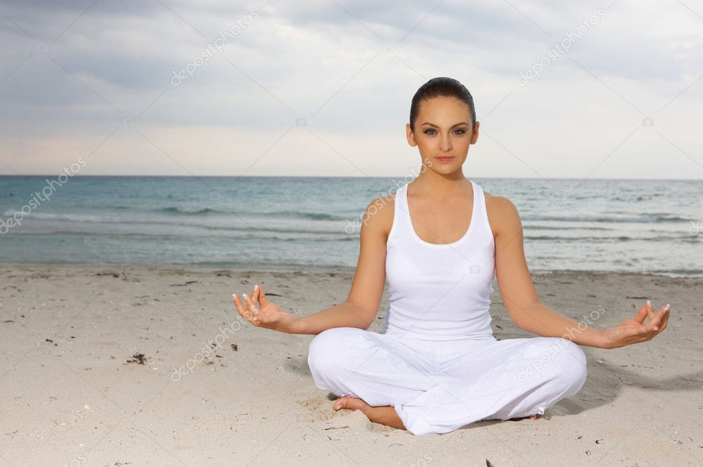 Young beautiful woman during yoga on sea beach   Foto de Stock   #1958927