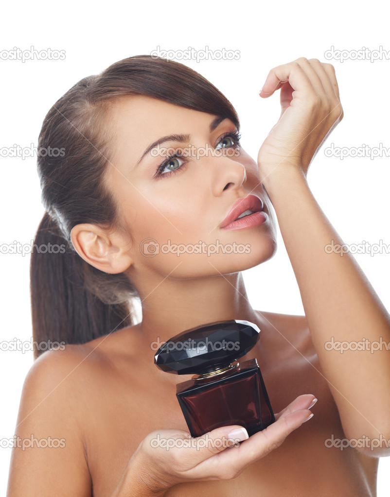 Portrait of beautiful and sexy woman with perfume bottle — Stock Photo #1959445