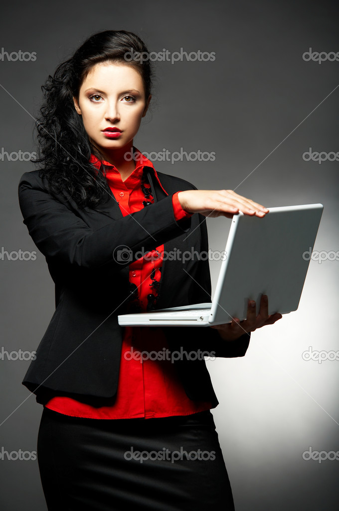 Young Business woman wearing red shirt and black jacket with laptop computer — Stock Photo #1959995