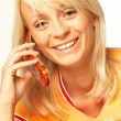 Woman talking cell phone — Stock Photo