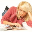 Stock Photo: Women reading magazine