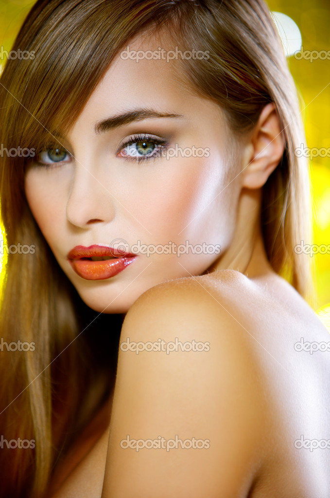 Portrait of beautiful young sexy woman on yellow background — Stock Photo #1960819