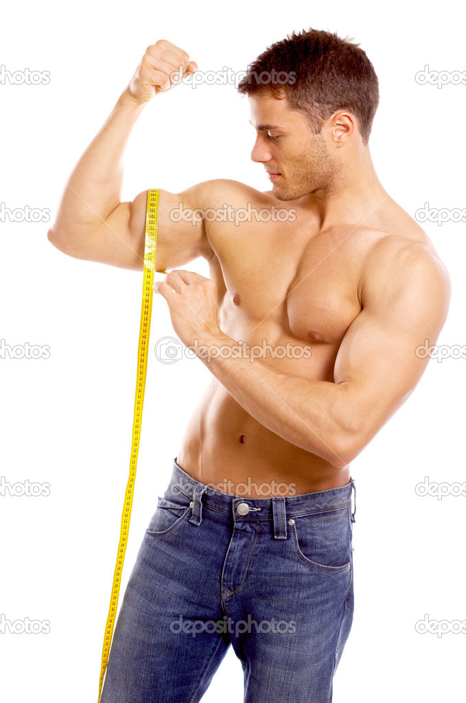 Muscular and tanned man is being measured  Stock Photo #1962021