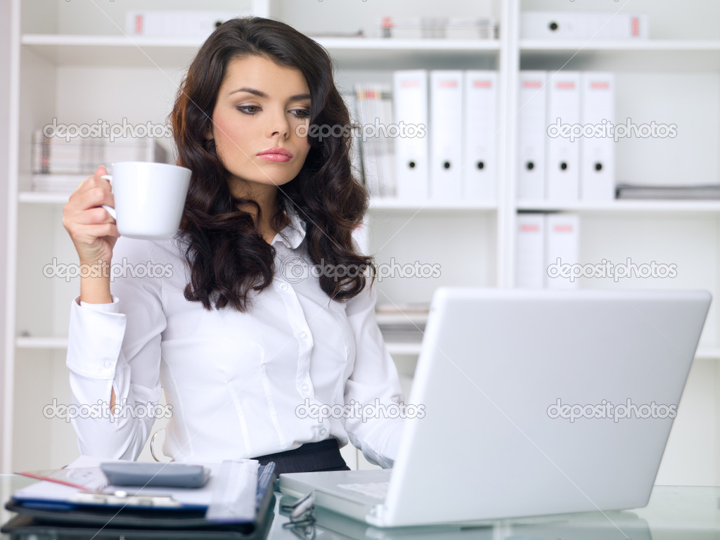 Beautiful business woman is working in office — Stock Photo #1962545