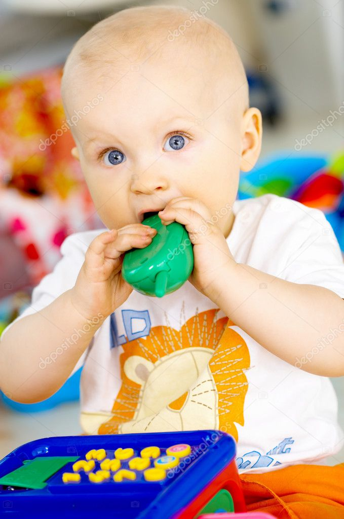 Portrait of sweet little baby boy with toys — Stock Photo #1962604
