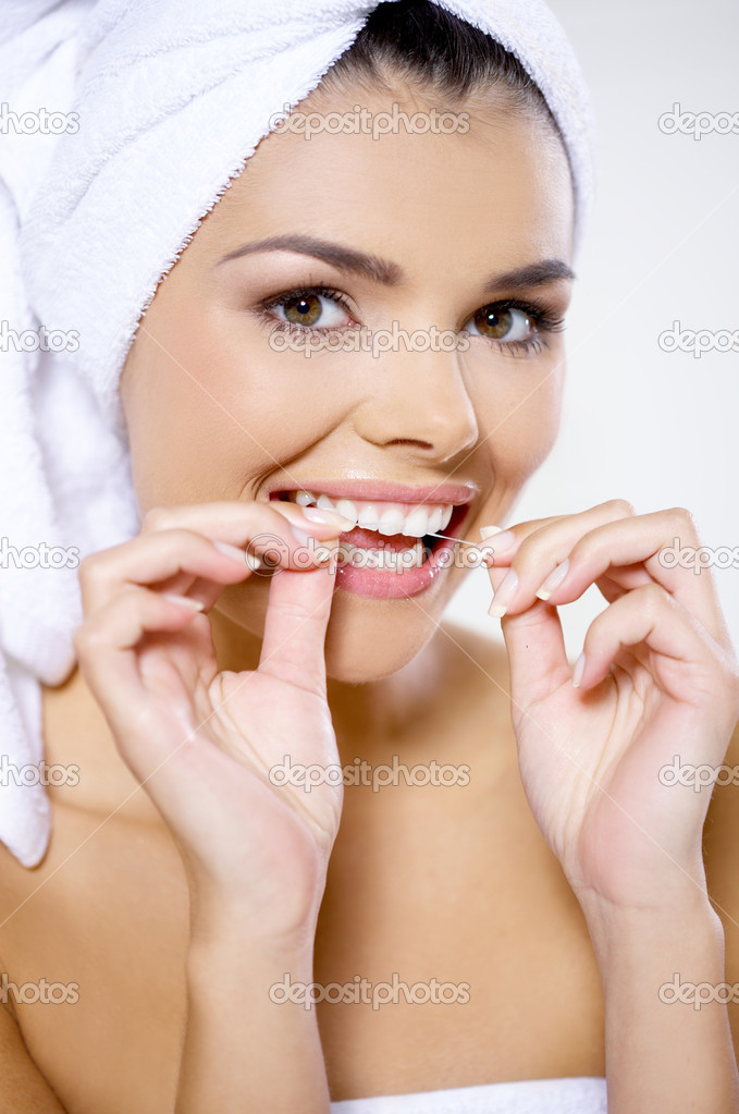 Portrait of beautiful woman with dental floss — Stock Photo #1963824