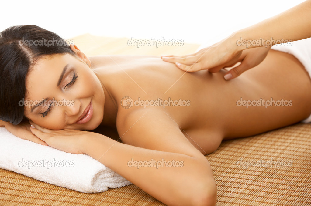 Portrait of Fresh and Beautiful brunette woman taking massage — Stock Photo #1968959