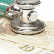 Stethoscope on the top of the money — Stock Photo