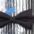 Stock Photo: Black bow-tie with label air mail