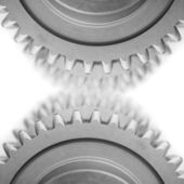 Gears and blured gears on white — Stock Photo