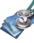A stethoscope by a Credit cards payment — Stock Photo