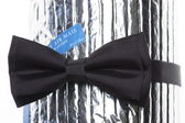 A black bow-tie with label air mail — Stock Photo