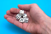 Five cubes in a hand before a throw — Stock Photo