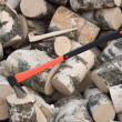 Axe thrust in a wooden stub — Stock Photo