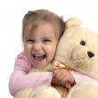 Cheerful girl with bear — Stock Photo