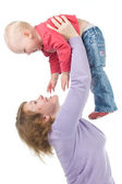 Mother raises up a cheerful daughter — Stock Photo