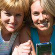 Two women with a handheld — Foto Stock