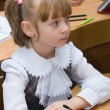 Girl in school in the classroom — Stock Photo