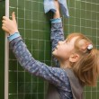 Stock Photo: The girl washes a blackboard