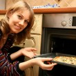 Stock Photo: The girl prepares a pizza