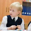 Stock Photo: Pupil in school in the classroom