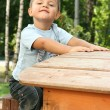 The boy on a children's playground — Stock Photo