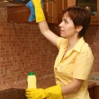 Stock Photo: Girl on kitchen wipes technics