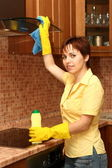 Girl on kitchen wipes technics — Stock Photo