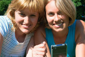 Two women with a handheld — Stock Photo