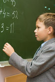 The schoolboy solves examples at a mathematics l — Stock Photo